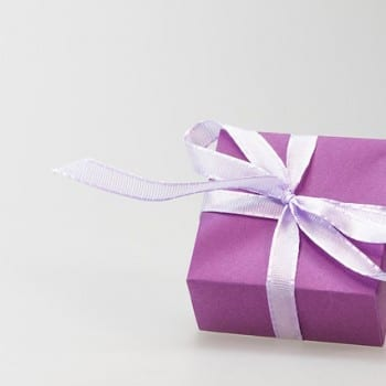 A gift wrapped in violet